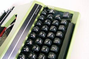 ¿Cómo se carga de cinta correctora de una máquina de escribir?