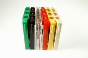 Las comparaciones entre un cassette de la cubierta y un reproductor de casetes