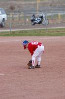 Cómo coser un parche de béisbol de la liga pequeña
