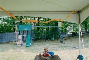 Cómo decorar una tienda al aire libre con tul para un partido de la princesa