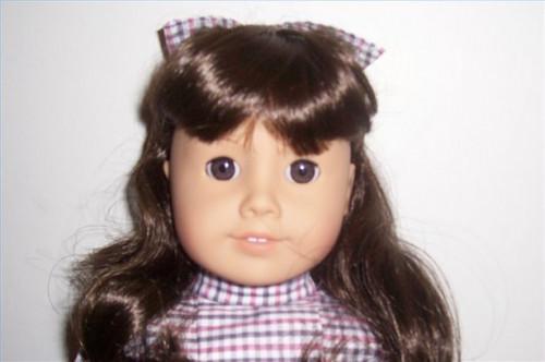 Cómo reparar una muñeca de niña americana