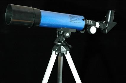 Cómo encontrar la ampliación de una lente telescópica